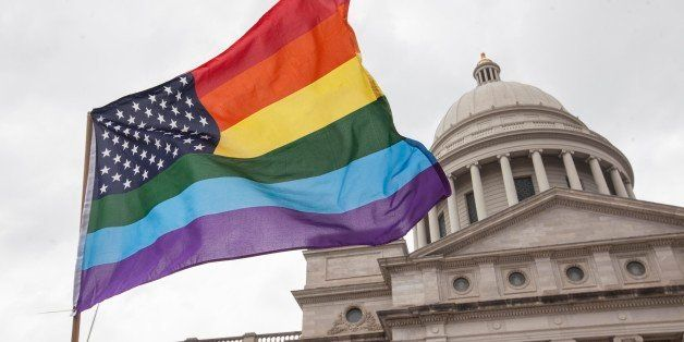 LITTLE ROCK, AR - APRIL 1:  A rainbow flag flies over the crowd during a press conference by the Human Rights Campaign on the
