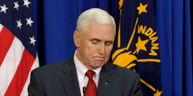 Indiana Gov. Mike Pence listens to a question during a news conference Tuesday, March 31, 2015, in Indianapolis. Pence said t