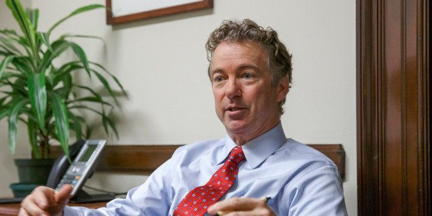 In this photo taken Feb. 10, 2015, Sen. Rand Paul, R-Ky. speaks in his office on Capitol Hill in Washington. In 2002, then Se