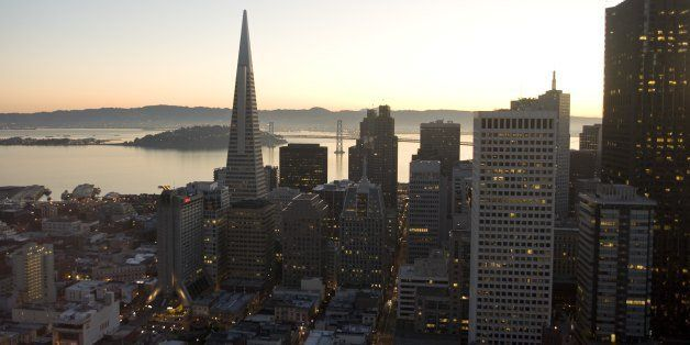 SAN FRANCISCO, CA - 2009:  The sun rises on the Transamerica Pyramid and other downtown high-rise buildings in this 2009 San