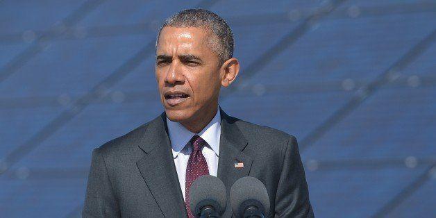 US President Barack Obama speaks about clean energy jobs at Hill Air Force Base in Utah on April 3, 2014. AFP PHOTO/ MANDEL N