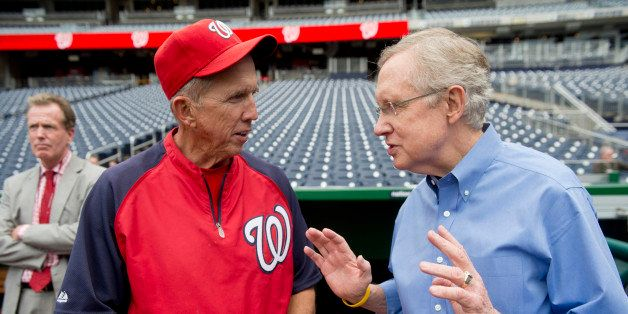 UNITED STATES - MAY 4: Senate Majority Leader Harry Reid, D-Nev., speaks with Washington Nationals manager Davey Johnson at N