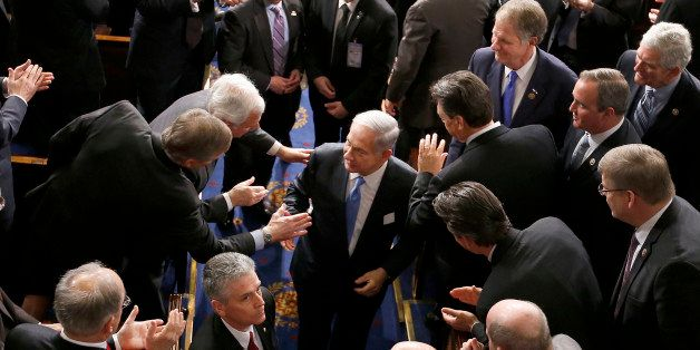 Israeli Prime Minister Benjamin Netanyahu shakes hands as he leaves the House chamber on Capitol Hill in Washington, Tuesday,