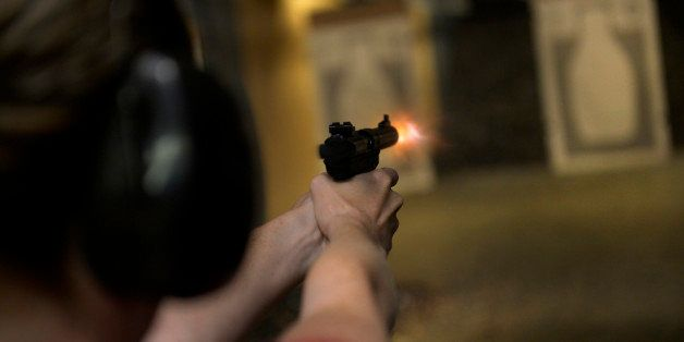 CENTENNIAL, CO. - JULY 27: Catherine Williams fires her handgun during a Multi-State Concealed Carry class at the Centennial