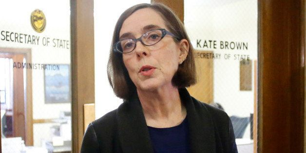 FILE - In this Feb. 13, 2015 file photo, Oregon Secretary of State Kate Brown speaks to the media outside of her office at th