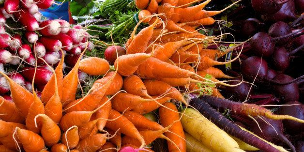 This photo taken on Oct. 5, 2013 shows radishes, carrots, turnips, and beets, at a farmer's market near Langley, Wash. Cool s