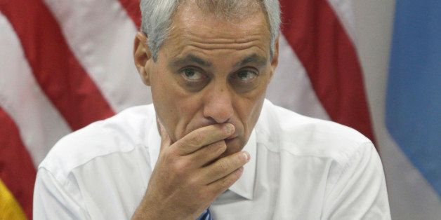 Chicago Mayor Rahm Emanuel looks at the crowd before a news conference Monday, July 21, 2014, in Chicago. Emanuel met with la