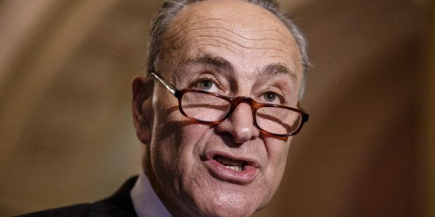 Sen. Chuck Schumer, D-N.Y., and Democratic leaders meet with reporters after Republicans gave up on their quest to stop fundi