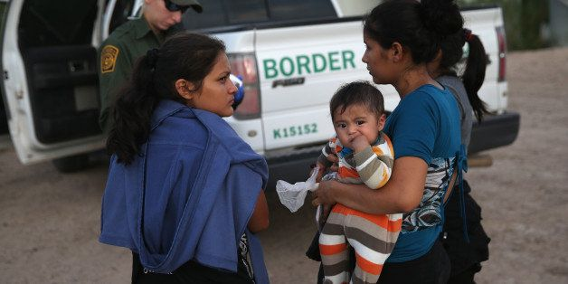 MCALLEN, TX - SEPTEMBER 08:  Families of Central American immigrants turn themselves in to U.S. Border Patrol agents after cr
