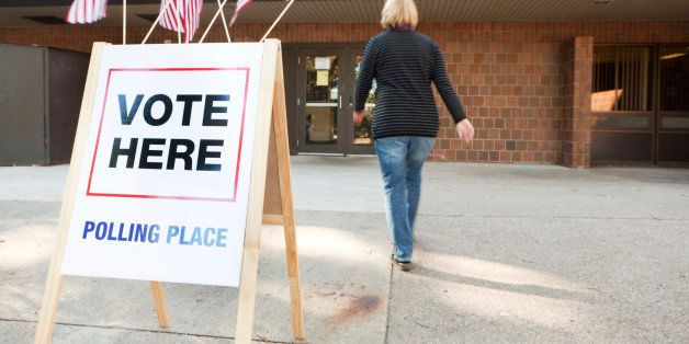 Subject: A voter approaching an election polling place station during a United States election.