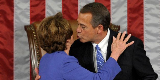 House Minority Leader Nancy Pelosi of Calif. gets a kiss from House Speaker John Boehner of Ohio after he was re-elected as H