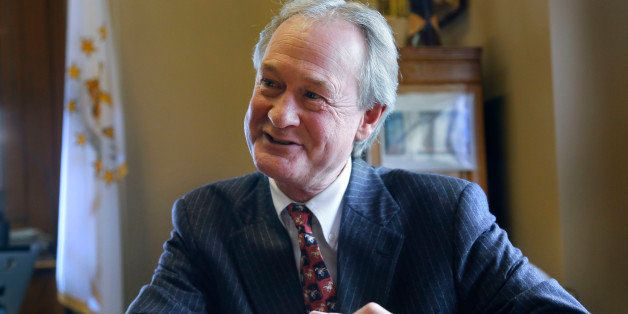 In this Thursday, Dec. 11, 2014 photo Rhode Island Gov. Lincoln Chafee responds to questions during an interview with The Ass
