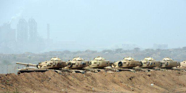 Saudi army tanks are seen deployed near the Saudi-Yemeni border, in southwestern Saudi Arabia, on April 9, 2015. The Saudi-le