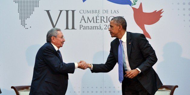 US President Barack Obama (R) shakes hands with Cuba's President Raul Castro (L) on the sidelines of the Summit of the Americ