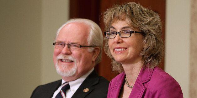 WASHINGTON, DC - APRIL 16:  U.S. Rep. Ron Barber (D-AZ) (L) and former U.S. Rep. Gabrielle Giffords (D-AZ) attend the dedicat