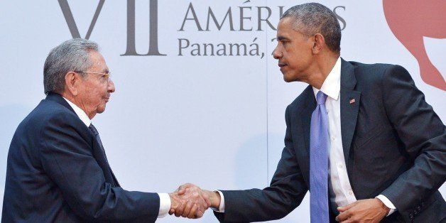 US President Barack Obama (R) shakes hands with Cuba's President Raul Castro during a meeting on the sidelines of the Summit