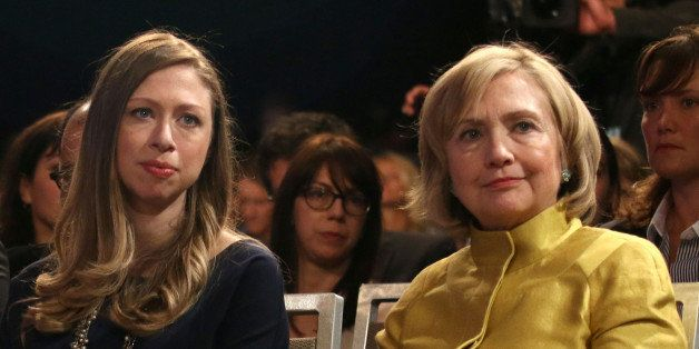 Former U.S. Secretary of State Hillary Clinton, right, and daughter Chelsea Clinton attend the closing plenary session of the