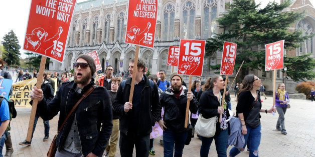 Students and other supporters protest, Wednesday, April 1, 2015, on the University of Washington campus in Seattle, in suppor