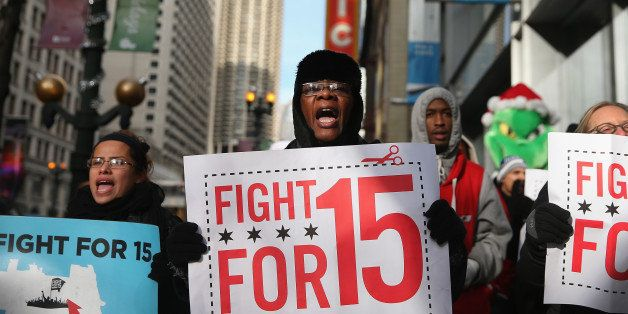 CHICAGO, IL - DECEMBER 05:  Demonstrators demanding an increase in pay for fast-food and retail workers protest in the Loop o