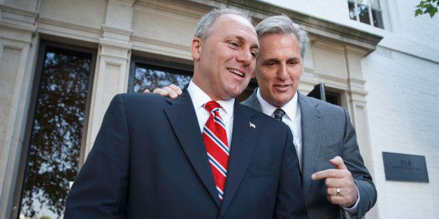 Majority Leader-elect Rep. Kevin McCarthy, R-Calif., right, talks with Rep. Steve Scalise, R-La., left, the newly elected Hou