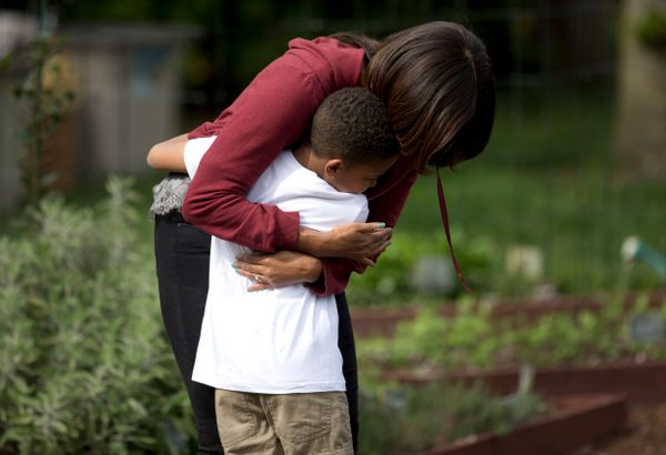 First lady Michelle Obama hugs Nare Kande, 9, a student from the New York Botanical Gardens in the Bronx, N.Y., after they wo