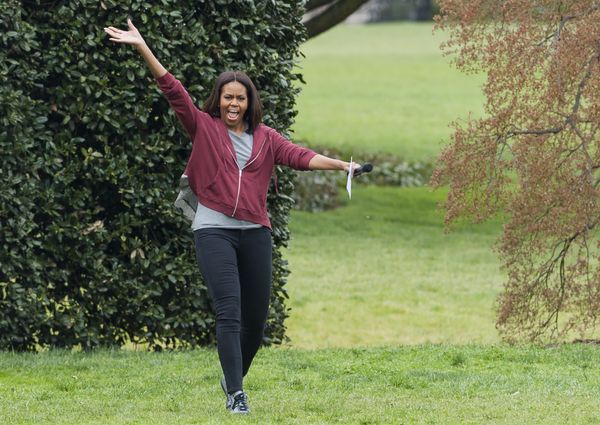 First lady Michelle Obama arrives to plant vegetables in the White House Kitchen Garden.