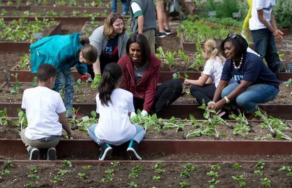 First lady Michelle Obama, joined by students from across the country, plants vegetables during the seventh annual White Hous