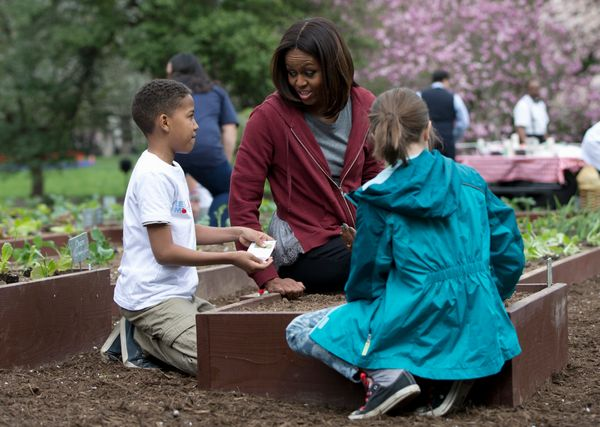First lady Michelle Obama, joined by students Nare Kande, 9, of the New York Botanical Gardens in the Bronx, N.Y., left, and