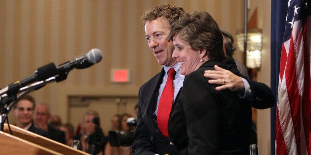 U.S. Sen. Rand Paul, R-Ky., hugs New Hampshire State GOP chairwoman Jennifer Horn as he is introduced at the New Hampshire Re