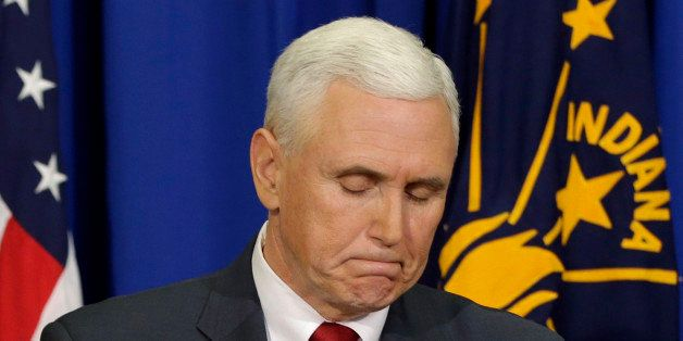 Indiana Gov. Mike Pence listens to a question during a news conference, Tuesday, March 31, 2015, in Indianapolis. Pence said