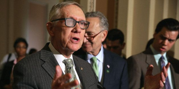 WASHINGTON, DC - MARCH 17:  Senate Minority Leader Harry Reid (D-NV) talks to reporters following the Senate Democratic polic