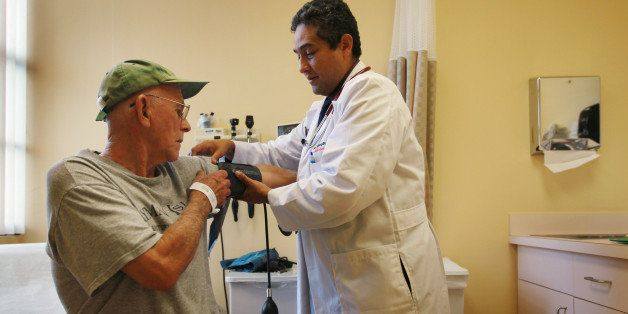 MIAMI - JANUARY 18:  Dr. Olveen Carrasquillo, Chief of General Internal Medicine University of Miami, conducts a checkup on J