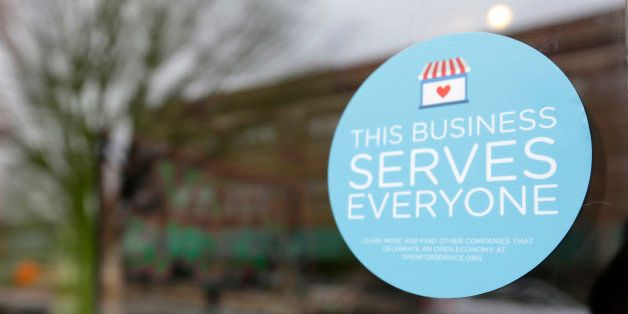 A window sticker on a downtown Indianapolis business, Wednesday, March 25, 2015, shows its objection to the Religious Freedom