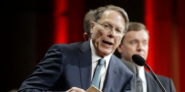 Wayne LaPierre, executive vice president of the National Rifle Association, presents an award during the annual meeting of me