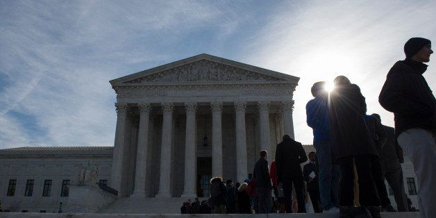 People wait in line outside the Supreme Court in Washington, Monday, March 23, 2015, in hopes to gain admittance for oral arg