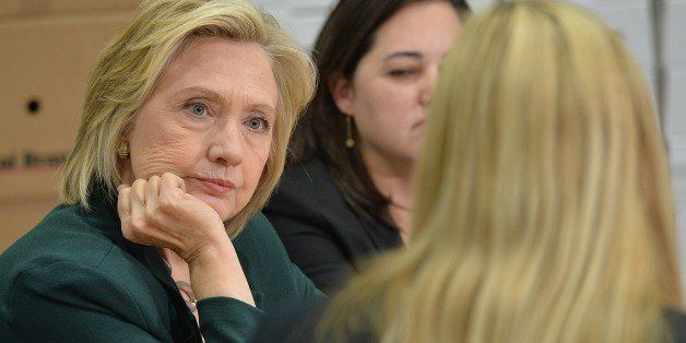Democratic presidential hopeful and former US Secretary of State, Hillary Clinton(C) participates in a small business roundta