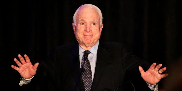 Sen. John McCain, R-Ariz. acknowledges the crowd for their standing ovation as McCain formally announces his candidacy for re