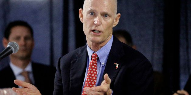 FILE - In this Feb. 5, 2015 file photo, Florida Gov. Rick Scott gestures during a cabinet meeting at the Florida State Fair,
