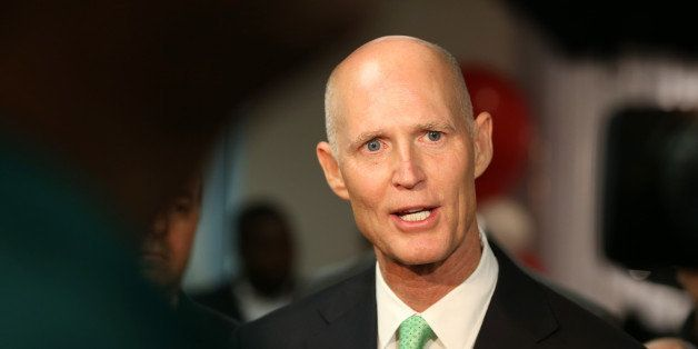 MIRAMAR, FL - JANUARY 23:  Florida Governor Rick Scott speaks to the media during a visit to SeaLand shipping lines new Intra
