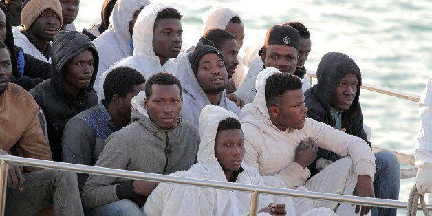 Migrants arrive at the Sicilian Porto Empedocle harbor, Italy, Monday, April 13, 2015. Italy's Coast Guard helped save 144 mi