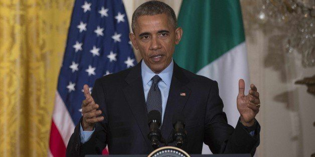 US President Barack Obama speaks during a joint press conference with  Italian Prime Minister Matteo Renzi at the White House