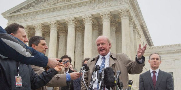 Michael Carvin, center, lead attorney for the petitioners, speaks to reporters outside the Supreme Court in Washington, Wedne