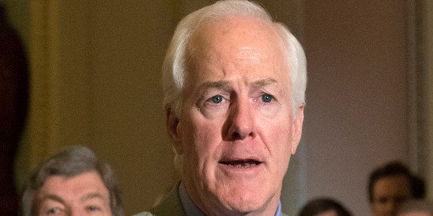 FILE - In this March 17, 2015 file photo, Senate Majority Whip John Cornyn of Texas speaks to reporters on Capitol in Washing