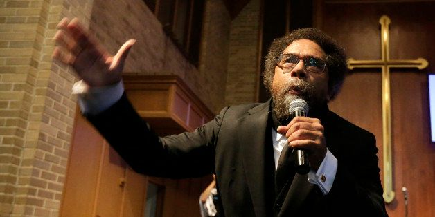 Cornel West talks to protesters before a march to the Ferguson, Mo., police station, Monday, Oct. 13, 2014, in Ferguson. Acti