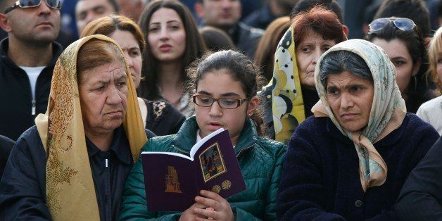 Armenians attend service in Echmiadzin, the religious center of the Armenian Church outside the Armenian capital, Yerevan, Th