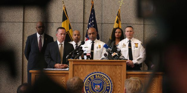 BALTIMORE, MD - APRIL 24:  Baltimore City Police Commissioner Anthony Batts (C) speaks during a news conference at the police