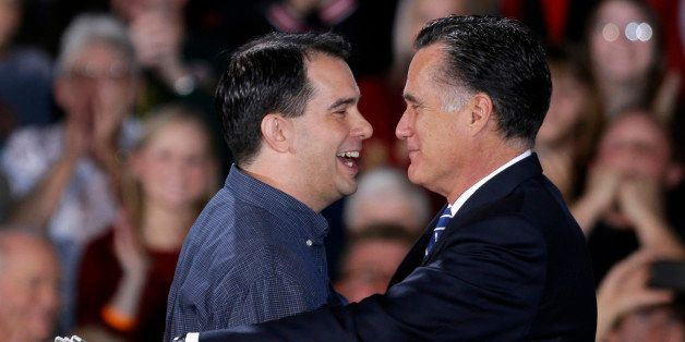 Republican presidential candidate, former Massachusetts Gov. Mitt Romney embraces Wisconsin Gov. Scott Walker who introduced him at a campaign event at Wisconsin Products Pavilion at State Fair Park, Friday, Nov. 2, 2012, in West Allis, Wis. (AP Photo/David Goldman)