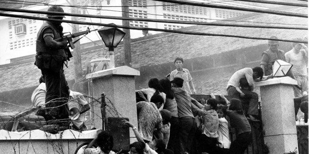 Mobs of Vietnamese people scale the wall of the U.S. Embassy in Saigon, Vietnam, trying to get to the helicopter pickup zone,