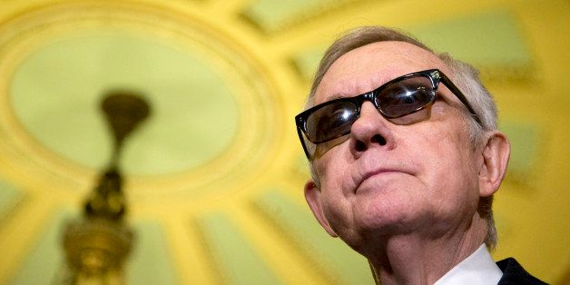 Senate Minority Leader Harry Reid of Nev. pauses during a news conference on Capitol Hill in Washington, Tuesday, April 14, 2