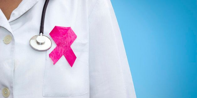 healthcare and medicine concept - female doctor with pink breast cancer awareness ribbon